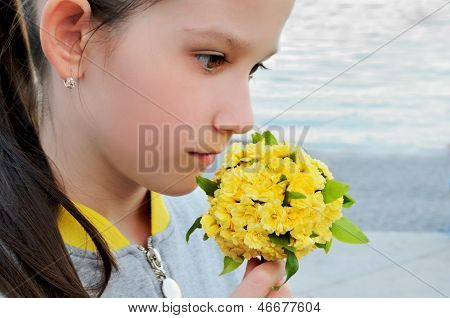 Girl With A Bouquet Of Yellow Flowers