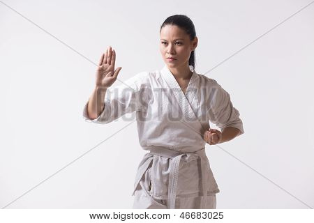 Beautiful woman in kimono on white