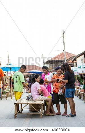 SUKHOTHAI, THAILAND - MAY 4 : Unidentified tourists are shopping and eating at Rim Yom 2437 night market on May 4, 2013 in Sukhothai, Thailand.
