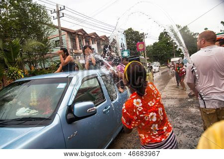 KO CHANG, THAILAND - APR 13: People celebrated Songkran Festival, on 13 Apr 2013 on Ko Chang, Thailand. Songkran is celebrated in Thailand as the traditional New Year by throwing water at each other.