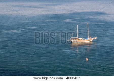 Sailboat And Motorboat In Sea
