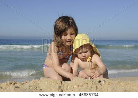 Summer vacation: Children playing in the sand on the beach