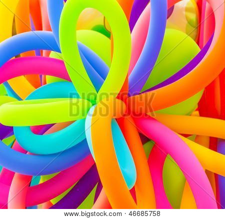 Colorful inflatable balloons background, abstract festive backdrop, birthday celebration, long filled helium balloon, happy holiday concept