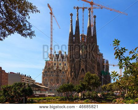 BARCELONA, SPAIN - APR 17, 2013: La Sagrada Familia - the impressive cathedral designed by Antonio Gaudi, which is being build since 1882 and is not finished yet April 17, 2013 in Barcelona, Spain.