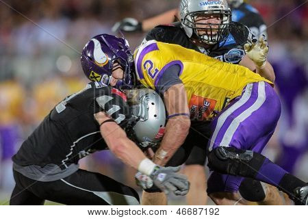 VIENNA, AUSTRIA - JULY 28 RB Dusty Thornhill (#2 Vikings) is tackled by DB Enrico Martini (#11 Raiders) on July 28, 2012 in Vienna, Austria.