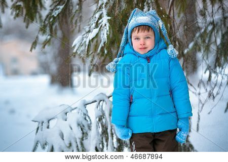 Cute little boy playing outdoors in a forest