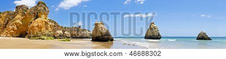 Panorama from natural rocks at Praia Tres Irmaos in Alvor Portugal
