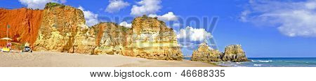 Panoramic view from rocks and ocean at Praia da Rocha in the Algarve Portugal