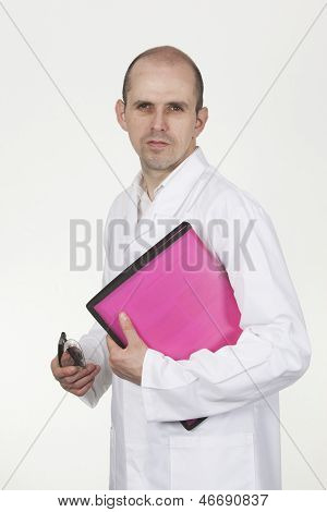Man In White Labcoat With Mobile And Pink File