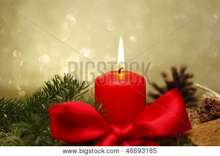 red candle with bow