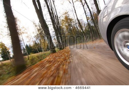 Car Driving On Country Road.