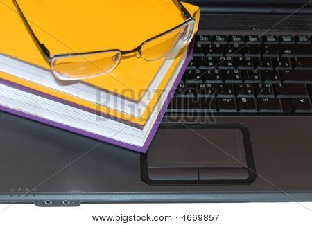 Multi-coloured Books And Glasses.