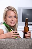 stock photo of teen smoking  - Teen with two bottles of beer - JPG