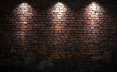 stock photo of brick block  - Old brick wall with stage lights - JPG