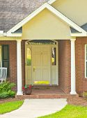 image of front-entry  - Traditional front door and entry way on residential house - JPG