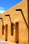Yellow Adobe House & Blue Sky poster