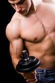 pic of muscle man  - Bodybuilder in action  - JPG