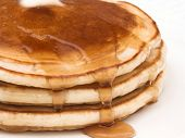 pic of ooze  - a stack of pancakes with melted butter and slathered with syrup oozing over the sides - JPG