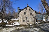 stock photo of fieldstone-wall  - Typical Canadian fieldstone House Frelighsburg - JPG