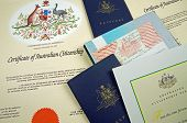 stock photo of citizenship  - various australian citizenship documents and two passports - JPG
