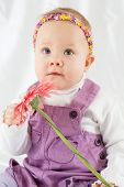 picture of pinafore  - Portrait of little girl in violet pinafore dress with headband in form of chaplet on her head - JPG