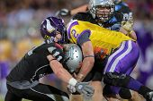 VIENNA, AUSTRIA - JULY 28 RB Dusty Thornhill (#2 Vikings) is tackled by DB Enrico Martini (#11 Raide