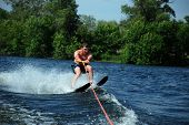 stock photo of ski boat  - Man skiing in the summer on the river - JPG