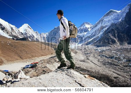 Hiker standing in the Khumbu Valley near the Mount Everest Base Camp in the Sagarmatha National Park in Nepal
