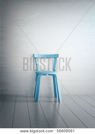 Empty old fashioned single chair standing against wall