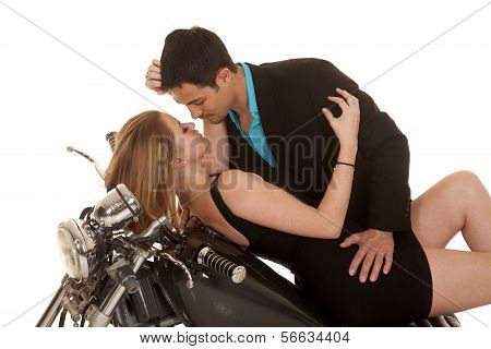 Couple Lay On Motorcycle Faces Close