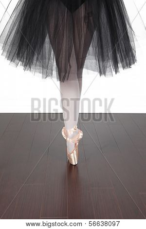 Ballerina dancing in studio with white background
