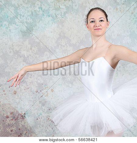 Ballerina dancing in studio with multicolor background