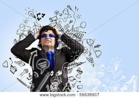 Image of depressed businessman tearing his hair