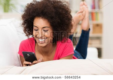 Beautiful Woman Texting On Her Mobile