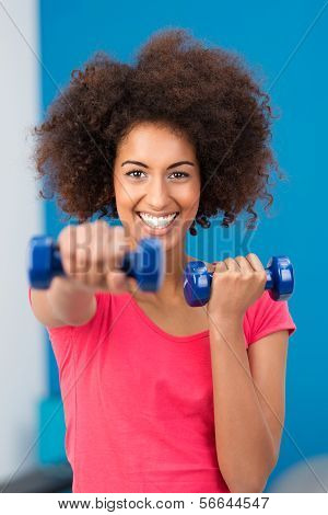 Happy Healthy Young Woman Working Out In A Gym