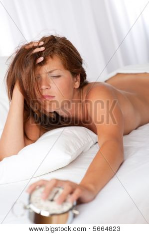 Tired Woman Holding Silver Alarm Clock