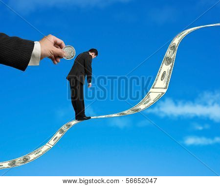 Businessman Standing On Money Trend With Coin Inserting Into Back