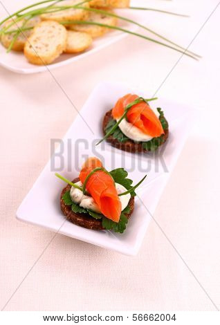 Smoked Salmon Roll On Pumpernickel Bread And Remoulade