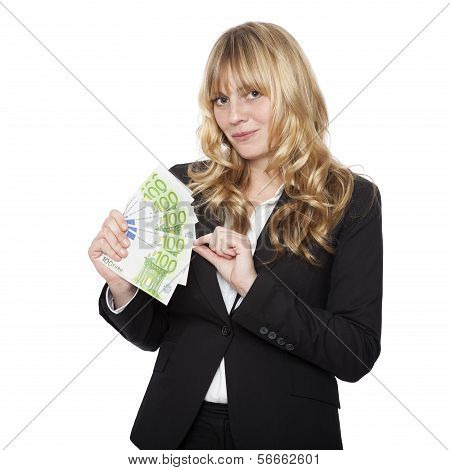 Businesswoman with a handful of 100 euro notes