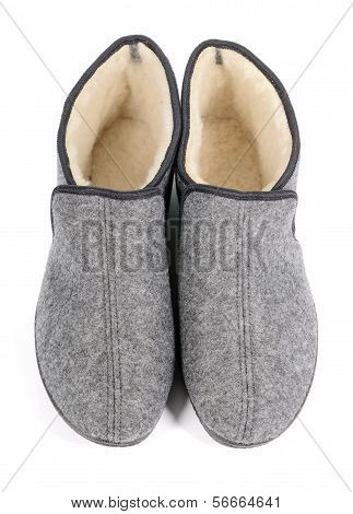 Pair Of Men's Grey Slippers On White Background.