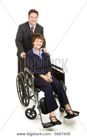 Disabled Businesswoman And Colleague