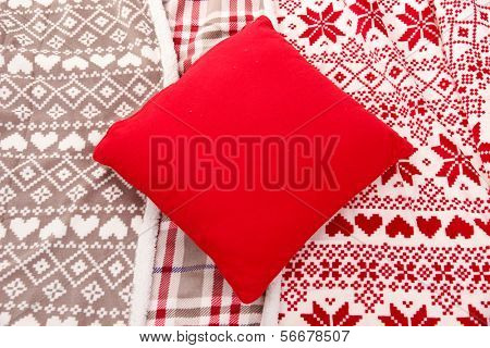 Warm plaids and pillow close-up background