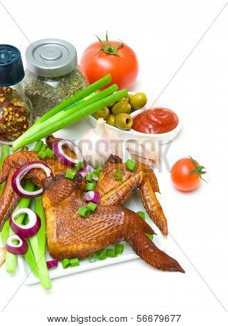 Smoked Chicken Wings And Vegetables On A White Background