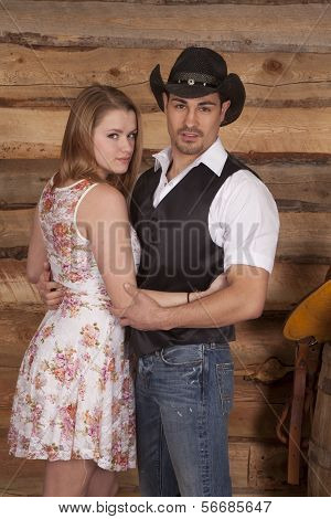 Cowboy With Woman In Arms Looking