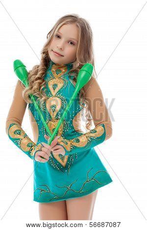 Portrait of pretty little gymnast posing with mace