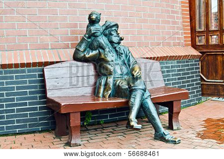 Sculpture Of The Old Skipper With A Monkey. Fishing Village, Kaliningrad, Russia