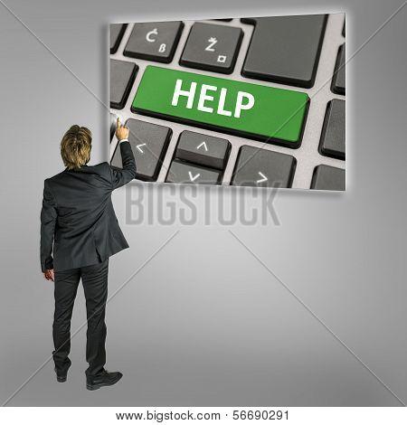 Businessman Using A Help Key On A Computer