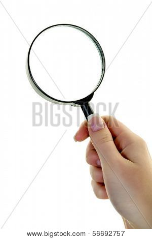 a hand holds a magnifying glass. viewed through the magnifying glass.