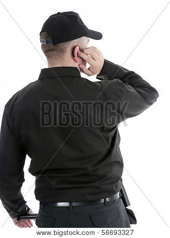 Security man wearing black uniform communicating using headset