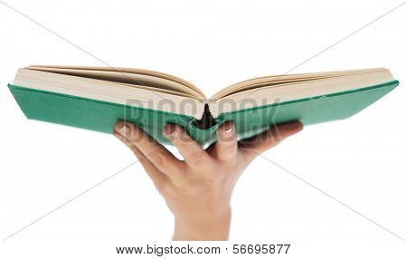 education and book concept - close up of woman hand holding open green book